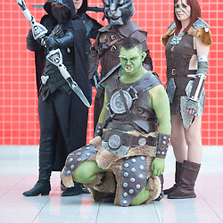 London, UK - 26 May 2013: a group dressed as characters of the videogame Sky Rim  poses for a picture during the London Comic Con 2013 at Excel London. London Comic Con is the UK's largest event dedicated to pop culture attracting thousands of artists, celebrities and fans of comic books, animes and movie memorabilia.