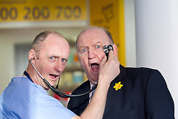 Repro Free:.Irish broadcaster, journalist and rugby union pundit George Hook gets his head examined by Dr Finbarr O'Connell, Consultant Physician at the launch of the Irish Cancer Society Daffodil Centre at St. James's Hospita. The Daffodil Centre is an extension of the Irish Cancer Society's Cancer Information Service at the point of diagnosis and treatment, the hospital. Pic Andres Poveda.