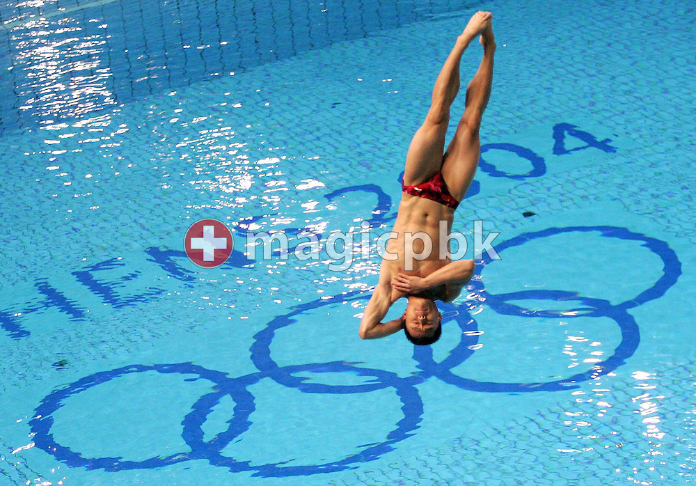 Bo Peng from China preforms a dive in the Men 3m Springboard Diving preliminary round competition at the Aquatic Center in Athens Monday 23 August 2004.    (Photo by Patrick B. Kraemer / MAGICPBK)