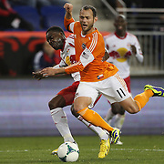 Brad Davis, Houston Dynamo, is challenge by Lloyd Sam  during the New York Red Bulls V Houston Dynamo , Major League Soccer second leg of the Eastern Conference Semifinals match at Red Bull Arena, Harrison, New Jersey. USA. 6th November 2013. Photo Tim Clayton