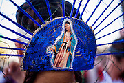 """10 OCTOBER 2010 - PHOENIX, AZ: The back of a Matachine's head piece in Phoenix Sunday. About 500 people processed through downtown Phoenix Sunday afternoon to honor the Virgin of Guadalupe, the """"Queen of the Americas."""" The procession was accompanied by 12 Matachine dance troupes. The Matachines are an important part of Mexican Catholic culture. They represent the battle of Good vs. Evil and the protect the Virgin from malevolent forces, represented by the demon like figures who accompany the dancers.      Photo by Jack Kurtz"""