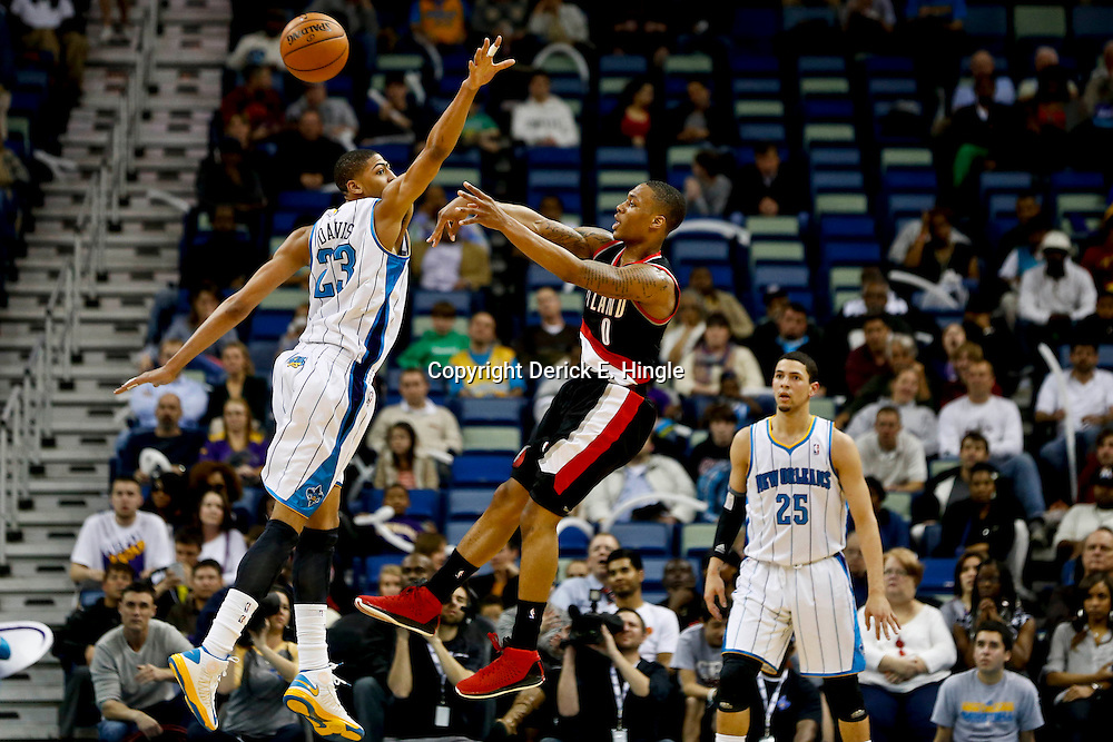 Feb 13, 2013; New Orleans, LA, USA; New Orleans Hornets power forward Anthony Davis (23) defends as Portland Trail Blazers point guard Damian Lillard (0) passes during the second quarter of a game at the New Orleans Arena. Mandatory Credit: Derick E. Hingle-USA TODAY Sports