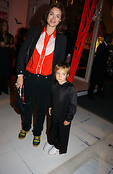 JASMINE GUINNESS and her son ELWOOD RAINEY at a party to celebrate the launch of DKNY Kids and Halloween in aid of CLIC Sargent and RX Art held at DKNY, 27 Old Bond Street, London on 31st October 2006.<br /><br />NON EXCLUSIVE - WORLD RIGHTS