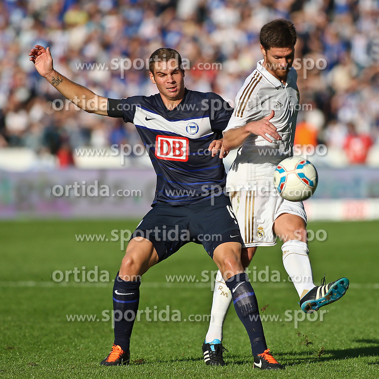 27.07.2011, Olympiastadion Berlin, GER, 1.FBL, Testspiel, Hertha BSC Berlin vs Real Madrid im Bild Pierre-Michel Lasogga (Hertha BSC Berlin #19) und Xabi Alonso (Real Madrid #14)   EXPA Pictures © 2011, PhotoCredit: EXPA/ nph/  Hammes       ****** out of GER / CRO  / BEL ******