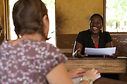 Cecilia, a teacher at Tizza Primary School, talking to VSO volunteer Cath, Ghana.