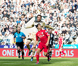NEWCASTLE-UPON-TYNE, ENGLAND - Sunday, April 1, 2012: Liverpool's Luis Alberto Suarez Diaz gets past Newcastle United's goalkeeper Tim Krul but fails to score during the Premiership match at St James' Park. (Pic by Vegard Grott/Propaganda)