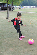 FALLS TOWNSHIP, PA - SEPTEMBER 06: Bailey Bennett, 3 years old, practices kicking the soccer ball after the opening day parade of Falls Soccer Club September 6, 2014 at Falls Community Park in Falls Township, Pennsylvania. (Photo by William Thomas Cain/Cain Images)