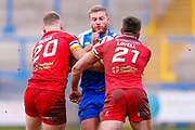 Halifax RLFC prop Will Maher (17) is stopped during the Betfred Championship match between Halifax RLFC and London Broncos at the MBi Shay Stadium, Halifax, United Kingdom on 8 April 2018. Picture by Simon Davies.