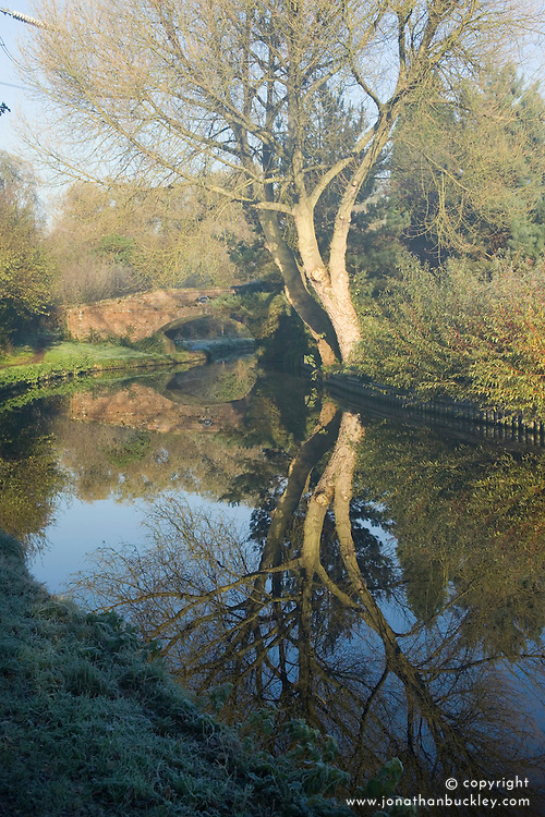 Reflections in the water of the Staffordshire and Worcester canal on a frosty morning in winter.
