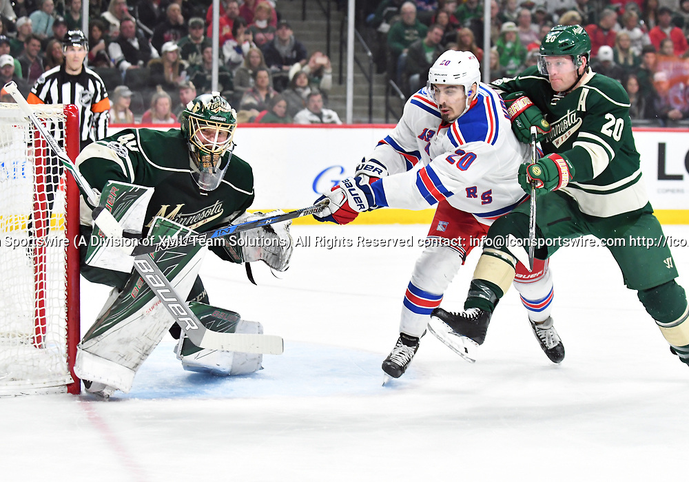ST. PAUL, MN - MARCH 18: Minnesota Wild Goalie Devan Dubnyk (40) makes a save as New York Rangers Left Wing Chris Kreider (20) and Minnesota Wild Defenceman Ryan Suter (20) do battle in front of him during an NHL game between the Minnesota Wild and New York Rangers at the Xcel Energy Center in St. Paul, MN. The Rangers defeated the Wild 3-2.(Photo by Nick Wosika/Icon Sportswire)