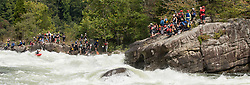 Kayakers watch others power their way through the rapids at Pillow Rock on the Gauley River during American Whitewater's Gauley Fest weekend. The upper Gauley, located in the Gauley River National Recreation Area is considered one of premier whitewater rivers in the country.
