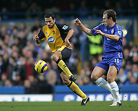 Photo: Lee Earle.<br /> Chelsea v Wigan Athletic. The Barclays Premiership.<br /> 10/12/2005. Chelsea's Arjen Robben (R) battles with Josip Skoko.