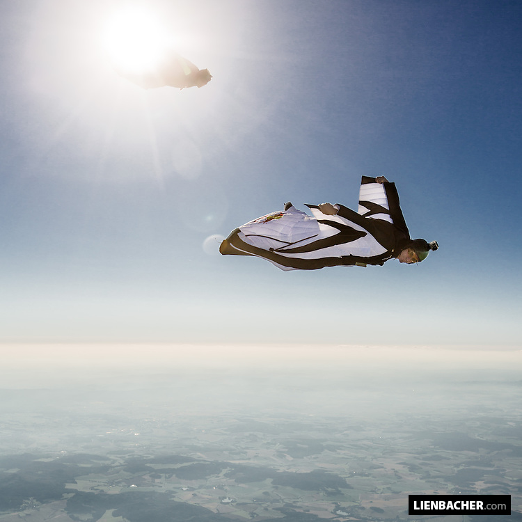 Dominic Roithmair from the Red Bull Skydive Team flying his wingsuit over Klatovy, being chased by Philip Ribis