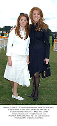 SARAH, DUCHESS OF YORK and her daughter PRINCESS BEATRICE, at a polo match in West Sussex on 18th July 2004.PXG 61