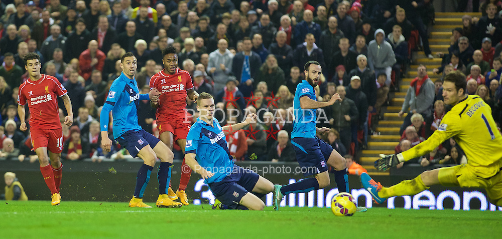 LIVERPOOL, ENGLAND - Saturday, November 29, 2014: Liverpool's Raheem Sterling sees his shot go wide of Stoke City's goalkeeper Asmir Begovic's post during the Premier League match at Anfield. (Pic by David Rawcliffe/Propaganda)
