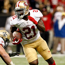 November 25, 2012; New Orleans, LA, USA; San Francisco 49ers running back Frank Gore (21) runs against the New Orleans Saints during the second half of a game at the Mercedes-Benz Superdome. The 49ers defeated the Saints 31-21. Mandatory Credit: Derick E. Hingle-US PRESSWIRE