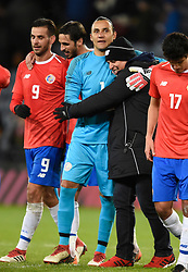 Costa Rica's goalkeeper Keilor Navas is hugged after the international friendly match at Hampden Park, Glasgow. RESTRICTIONS: Use subject to restrictions. Editorial use only. Commercial use only with prior written consent of the Scottish FA.