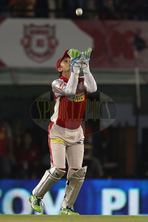 Adam Gilchrist takes the catch to dismiss Karan Sharma during match 59 of of the Pepsi Indian Premier League between The Kings XI Punjab and the Sunrisers Hyderabad held at the PCA Stadium, Mohal, India  on the 11th May 2013..Photo by Ron Gaunt-IPL-SPORTZPICS ..Use of this image is subject to the terms and conditions as outlined by the BCCI. These terms can be found by following this link:..http://www.sportzpics.co.za/image/I0000SoRagM2cIEc