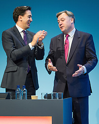 © Licensed to London News Pictures . 23/09/2013 . Brighton , UK . Ed Miliband applauds following Ed Balls ' , MP for Morley and Outwood and Shadow Chancellor of the Exchequer , address to the conference this afternoon (Monday 23rd September 2013) . Day 2 of the Labour Party 's annual conference in Brighton . Photo credit : Joel Goodman/LNP