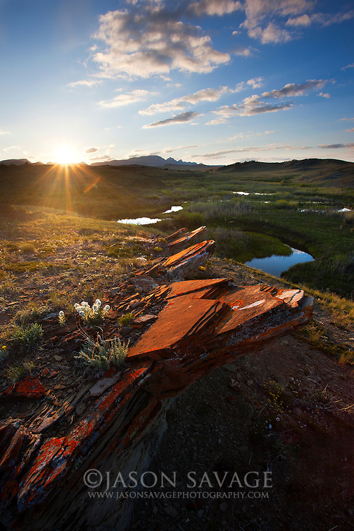 Sunset over the Nature Conservancy's Pine Butte Swamp Preserve at the Rocky Mountain Front, Montana.