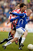 Photo: Leigh Quinnell.<br /> Leicester City v Southampton. The FA Cup. 28/01/2006.<br /> Leicesters Iain Hume sticks his tongue out as he gets away from Southamptons Claus Lundekvam.