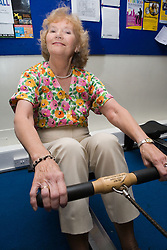 Women using rowing machine equipment in a YMCA gym,