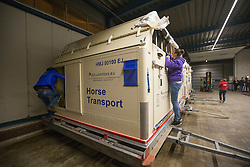Vannesa Ruiter and Anna Visser checking on there horses <br /> Departure of the horses to the World Cup Finals in Las Vegas from Schiphol - Amsterdam 2015.<br />  © Hippo Foto - Dirk Caremans