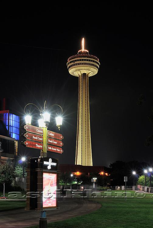 Exterior of Skylon Tower at night.