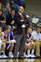 05 March 2005<br /> <br /> Hanover College Head Coach Mike Beitzel.<br /> <br /> Panthers celebrate an 81 - 76 Victory.  The Shirk Center was less than standing room only as 2850 shoe-horned into a 2500 capacity facility.  Hanover was one of only 4 teams to beat the Titans in regular season play. The Titans end the year 21 - 5.  The Panthers continue the trail to Salem with a 24 - 6 record.<br /> <br /> NCAA Division III 2nd Round Regional Playoffs.  Illinois Wesleyan University Titans V Hanover College Panthers.  Shirk Center, Illinois Wesleyan University, Bloomington IL