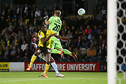 Burton Albion forward Lucas Akins (10) and Burton Albion goalkeeper Harry Campbell (20) shield the danger from Aston Villa forward Rushian Hepburn-Murphy (29) during the second round or the Carabao EFL Cup match between Burton Albion and Aston Villa at the Pirelli Stadium, Burton upon Trent, England on 28 August 2018.