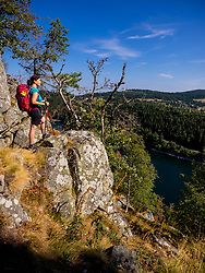 Rear view of women hiker looking at view of forest from mountains at Lac Blanc, Vosges, France