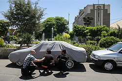 Iranian's take a cover outside the Iranian parliament during an attack on the complex in the capital Tehran on June 7, 2017. Gunmen and suicide bombers carried out coordinated attacks on Iran's parliament and the tomb of revolutionary founder Ruhollah Khomeini on June 7, 2017, state media reported, killing at least three people. Photo by Vahabzadeh FarsNews/ParsPix/ABACAPRESS.COM