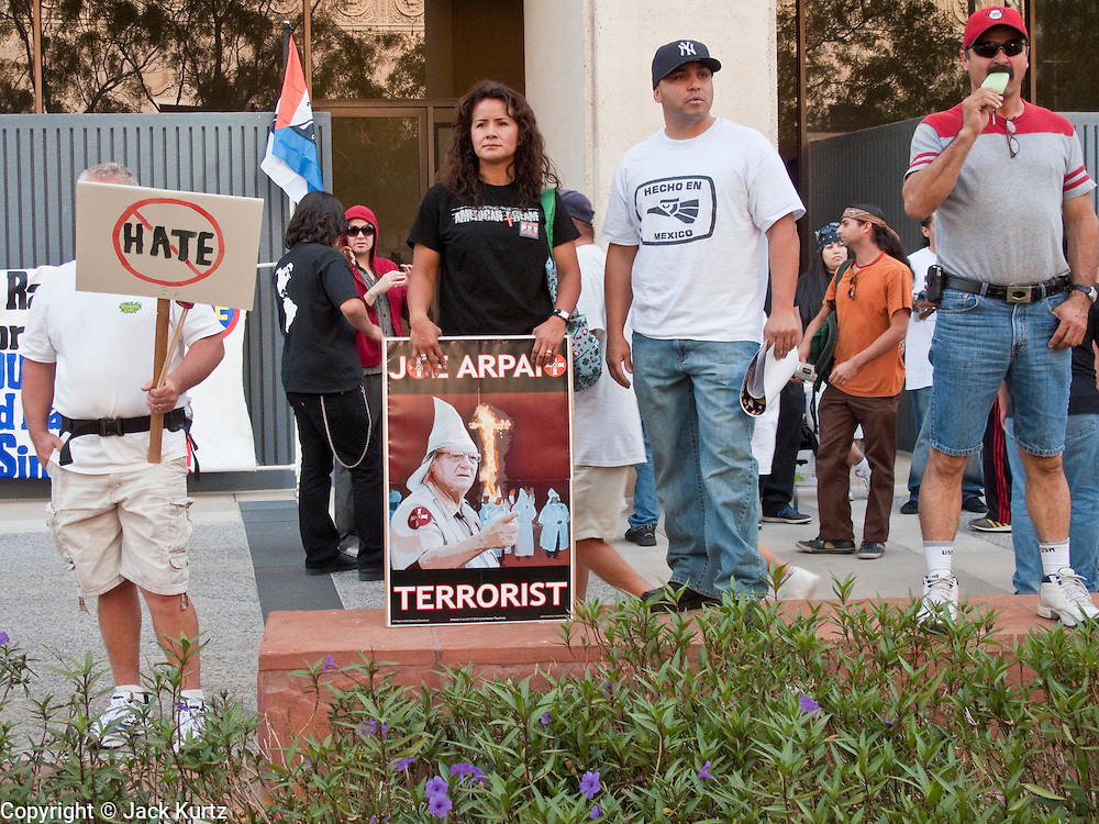 02 MAY 2009 -- PHOENIX, AZ: People gather at Cesar Chavez Plaza in Phoenix to start the march to the county jails on Durango Saturday. About 1,500 people opposed to Sheriff Joe Arpaio's treatment of prisoners and his high profile crime suppression anti-undocumented raids, marched from his office to downtown Phoenix to the jail complexes on Durango in south Phoenix Saturday. Photo by Jack Kurtz