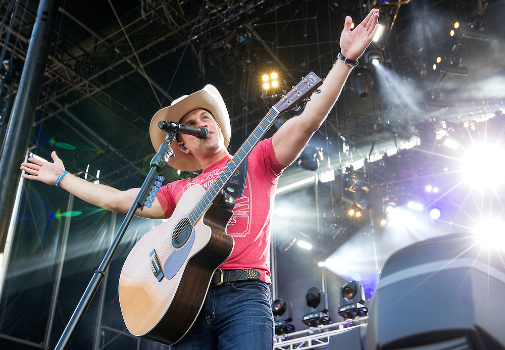 Dustin Lynch performs first during the Luke Bryan Kick The Dust Up Tour at TCF Bank Stadium in Minneapolis June 20, 2015.