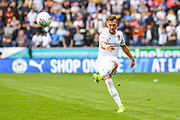 Leeds United defender Barry Douglas (3) passes the ball during the EFL Sky Bet Championship match between Wigan Athletic and Leeds United at the DW Stadium, Wigan, England on 17 August 2019.