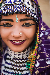 An Indian tribal girl from the Thar Desert wearing a decorative purple sari, Rajasthan, India