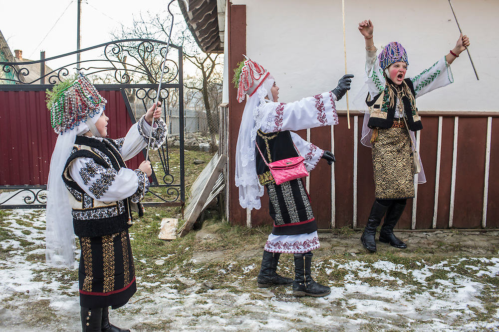 KRASNOILSK, UKRAINE - JANUARY 14: Children take part in the winter festival of Malanka on January 14, 2015 in Krasnoilsk, Ukraine. The holiday, which involves dressing in elaborate costumes and going from house to house as a group singing traditional songs, is celebrated on New Year's Day of the Orthodox calendar, a week after Orthodox Christmas.