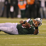 Geno Smith, New York Jets, after being sacked during the New York Jets Vs Chicago Bears, NFL regular season game at MetLife Stadium, East Rutherford, NJ, USA. 22nd September 2014. Photo Tim Clayton for the New York Times