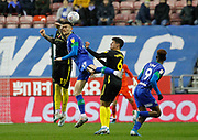 Kiefer Moore(19) of Wigan Athletic and Pontus Jansson(18) of Brentford during the EFL Sky Bet Championship match between Wigan Athletic and Brentford at the DW Stadium, Wigan, England on 9 November 2019.