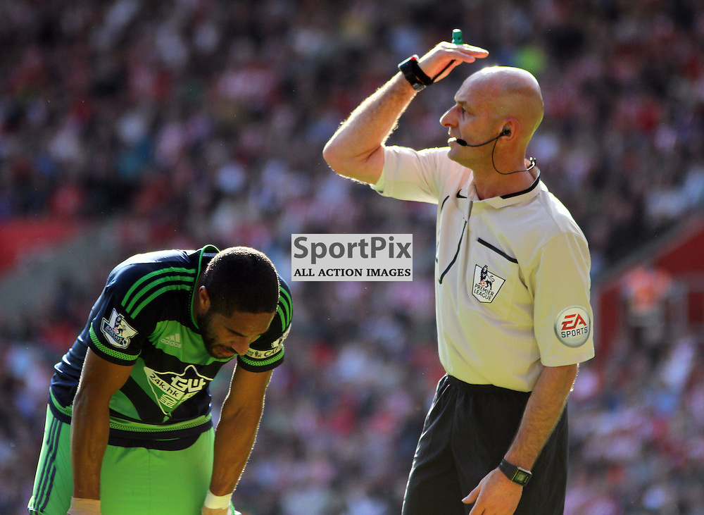 Ashley Williams takes a breather whilst the referee calls on the a physio During Southampton vs Swansea on Saturday 26th September 2015.