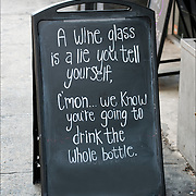 Humorous outdoor sign in front relects the sense of humor and attitude of the store's owner.<br />