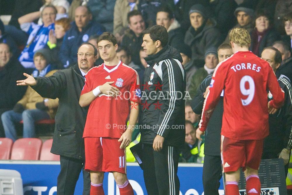 WIGAN, ENGLAND - Wednesday, January 28, 2009: Liverpool's manager Rafael Benitez prepares to bring on Albert Riera to replace Fernando Torres during the Premiership match against Wigan Athletic at the JJB Stadium. (Mandatory credit: David Rawcliffe/Propaganda)