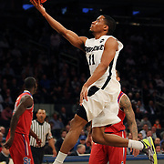 Bryce Cotton, Providence, drives to the basket during the Providence Vs St. John's Red Storm basketball game during the Big East Conference Tournament at Madison Square Garden, New York, USA. 12th March 2014. Photo Tim Clayton