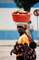 Dubbed by some as Walking Shops, ladies carry fruit in their buckets, selling as they go.
