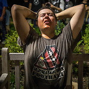 CHARLOTTESVILLE,VA-AUG11:A white nationalist is  overcome with tear gas after hundreds of white nationalists and white supremacists carrying torches marched in a parade through the University of Virginia campus. Beginning a little after 9:30 p.m., the march lasted 15 to 20 minutes before ending in skirmishing when the marchers were met by a small group of counterprotesters at the base of a statue of Thomas Jefferson, the university's founder. (Photo by Evelyn Hockstein/For The Washington Post)