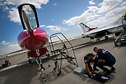 SSgt. Eduardo Sibaja and TSgt. Michael Davis perform cockpit maintenance on the #5 Thunderbird F-16 after the Thunderbirds arrived at Fairchild Air Force Base early Thursday afternoon. The Thunderbirds are composed of eight pilots, four support officers, and more than 130 enlisted personnel in twenty-five career fields.