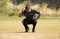 Golf - 2013 Open Championship at Muirfield - Friday Round Two<br /> Lee Westwood of England lines up a putt on the 2nd green