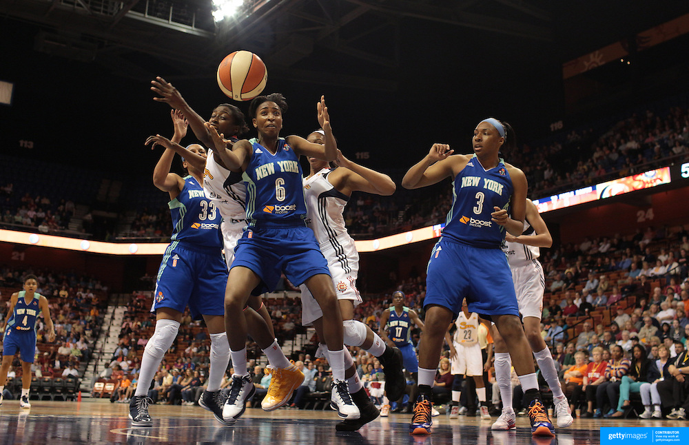 Shenneika Smith, (number six), New York Liberty, rebounds under pressure from Kalana Greene, Connecticut Sun, during the Connecticut Sun V New York Liberty WNBA pre season game at Mohegan Sun Arena, Uncasville, Connecticut, USA. 11th May 2013. Photo Tim Clayton