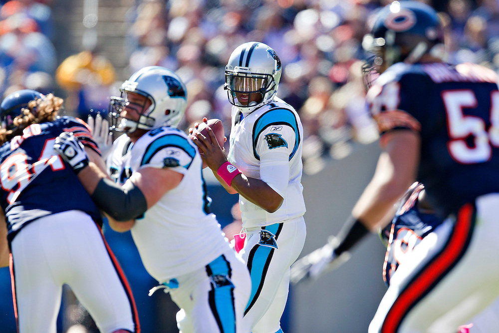 CHICAGO, IL - OCTOBER 2:   Cam Newton #1 of the Carolina Panthers drops back to pass against the Chicago Bears at Soldier Field on October 2, 2011 in Chicago, Illinois.  The Bears defeated the Panthers 34 to 29.  (Photo by Wesley Hitt/Getty Images) *** Local Caption *** Cam Newton