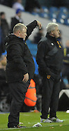 Steve Evans manager of of Leeds United and Steve Bruce manager of Hull City during the Sky Bet Championship match at Elland Road, Leeds<br /> Picture by Graham Crowther/Focus Images Ltd +44 7763 140036<br /> 05/12/2015
